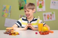 Pietluttige eter en zijn dieet stock afbeeldingen
