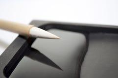 Pietra cinese dell'inchiostro dei pennelli Fotografie Stock