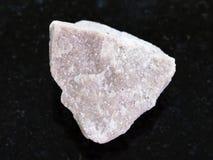 pietra cruda della dolomia su fondo scuro Fotografia Stock Libera da Diritti
