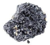 pietra cruda della perovskite (minerale metallifero di titanio) su bianco fotografia stock