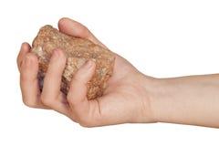 Pietra del granito in sua mano Fotografia Stock Libera da Diritti