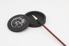 Pietra dell'inchiostro e della spazzola Fotografia Stock