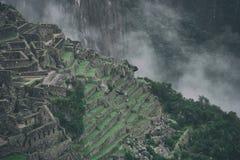Pietra e nebbia di Machu Picchu Immagine Stock