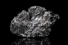 Pietra minerale ruvida della grafite, carbonio nero dell'esemplare immagini stock