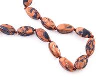 Pietra preziosa arancio di Aventurine dell'oro di marrone minerale della gemma su bianco Immagine Stock
