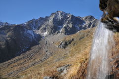Pietra Rossa with small waterfall, Stelvio NP Stock Image