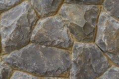 Pietra ruvida delle tonalità differenti, parete di pietra impilata Fotografia Stock
