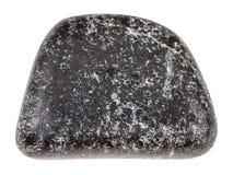 Pietra ruzzolata della cromite isolata su bianco Immagini Stock Libere da Diritti