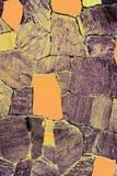 Pietra stagionata della parete con gli elementi gialli per il vostro fondo immagine stock libera da diritti