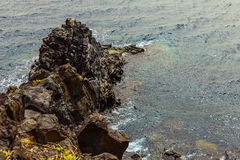 Pietre della spiaggia nel fondo dell'estratto dell'oceano Fotografia Stock
