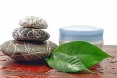 Pietre della stazione termale e terapia crema immagine stock