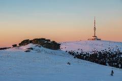 Pietre di Peters e collina di Praded con il trasmettitore al tramonto Fotografia Stock