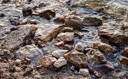 Pietre e rocce del mare sulla spiaggia Fotografia Stock