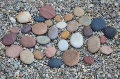Pietre liscie colorate lucidate dal lago Baikal abilmente Immagini Stock Libere da Diritti