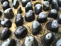 Pietre rotonde liscie Immagini Stock
