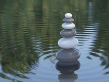 Pietre scure e bianche di zen in un lago Immagini Stock