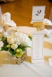 Pieza central y menú de la boda Foto de archivo libre de regalías
