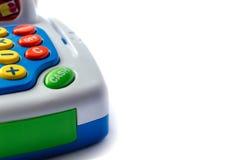 Pieza de la caja registradora del juguete En un fondo blanco, aislado en blanco Fotos de archivo