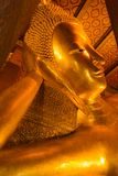 Pieza de la cara del oro de la estatua de Buda en templo del pho del wat foto de archivo libre de regalías