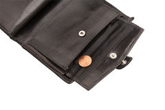 Pieza de la carpeta negra abierta con la moneda Imagen de archivo