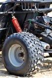Pieza de la motocicleta de la arena de la playa Foto de archivo