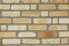 Pieza de la pared de un ladrillo amarillo Fotografía de archivo