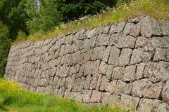 Pieza de una pared de piedra Foto de archivo libre de regalías