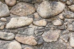 Pieza de una pared de piedra, para el fondo o la textura Imágenes de archivo libres de regalías
