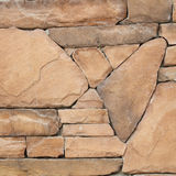 Pieza de una pared de piedra, para el fondo o la textura Fotos de archivo libres de regalías