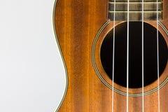 Pieza del ukelele de Brown aislada en blanco Imagen de archivo libre de regalías