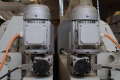 Piezas mecánicas de maquinaria industrial Imagenes de archivo