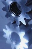 Piezas titanium azules del engranaje Imagen de archivo libre de regalías