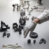 Piezas y mano de la máquina Imágenes de archivo libres de regalías