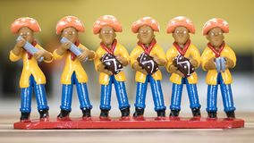 Pifanos Band. Typical Brazilian clay sculpture painted in vibrant colors representing a Pifanos Band and used as home decoration in the Northeast of Brazil Royalty Free Stock Image