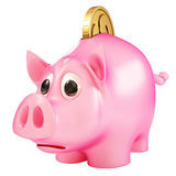 Pig. A piggy bank with a coin going into it Royalty Free Stock Image