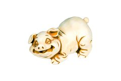 Pig. Isolated on white: toy - ceramics young pig Royalty Free Stock Image