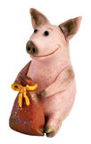 Pig with a bag of money. Handmade, toy from the salty test: a pig with a bag of money, a symbol of riches and Year of the Pig royalty free stock photo