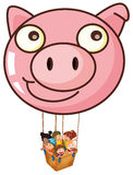 A pig balloon carrying a basket with kids Stock Photo
