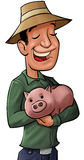 The pig bank. Young farmer with a pig bank in his hands, he looks happy Stock Photography