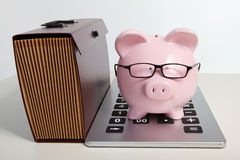Pig bank and brief case Stock Photo