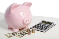 Pig bank and money. Pig bank and a lot of money coin and bills Stock Images