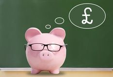 Pig bank and pound sterling. Pig bank and thoughts about the pound sterling Stock Image