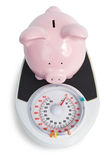 Pig bank and scales Stock Photos