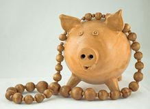 Pig and beads Stock Image