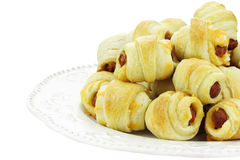 Pig in Blankets. Plate of sausage rolls isolated on a white background Royalty Free Stock Image