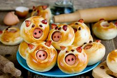Pig buns stuffed with sausage - funny baking idea shaped cute piggy faces royalty free stock photos