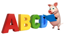 Pig cartoon character with abcd sign  and books Royalty Free Stock Photo