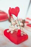 Pig couple. Made of marzipan Stock Photos