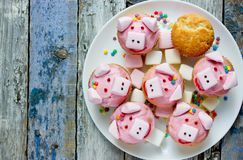 Pig cupcakes, animal shaped funny cakes for kids. Party, piggy cupcakes with pink frosting and marshmallow stock photo