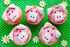 Pig cupcakes, animal shaped funny cakes for kids. Party, piggy cupcakes with pink frosting and marshmallow royalty free stock photos